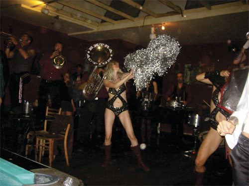 sexy pom pom girl dancing in bar