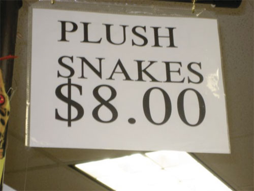 sign that says plush snakes 8 dollars