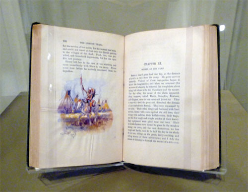 Charles Marion Russell book with watercolor on a page